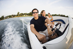 image of man driving boat